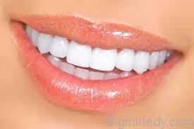 Причини чорного нальоту на зубах і способи його усунення