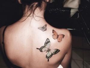Татуювання на жіночій спині - відображення індивідуальності чи данина моді